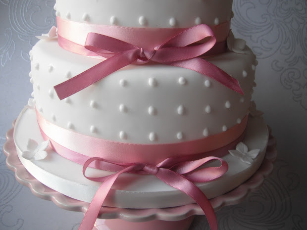 Pink Ribbon And Roses Wedding Cake