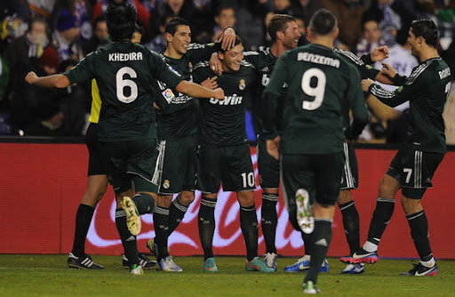 Mesut Özil celebrates with Real Madrid teammates after scoring against Valladolid