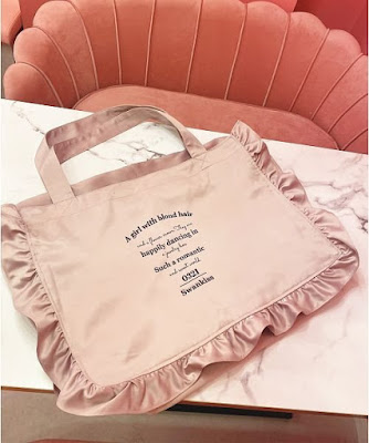 pink bag on a white table