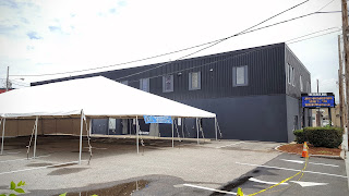 the tent is set up and ready for Saturday's Cultural Festival events at THE BLACK BOX