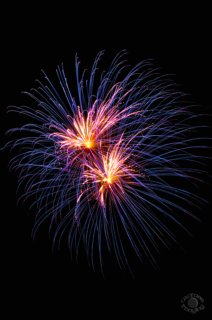 Cramer Imaging's professional quality fine art photograph of two blue and pink fireworks in Idaho Falls, Bonneville, Idaho