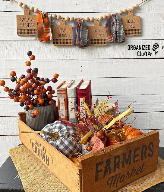 Photo of a DIY fall banner & fall season crate vignette.