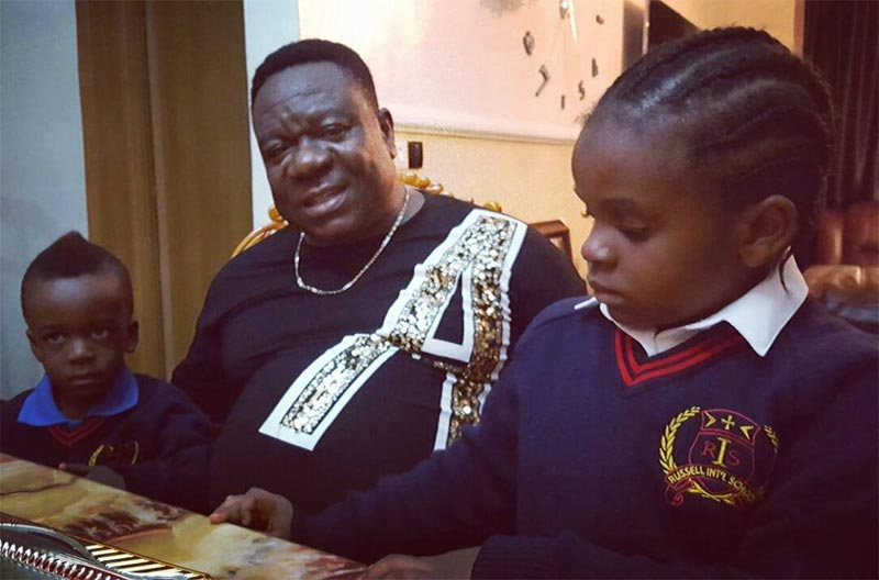 Mr. Ibu shows off his children heading to school