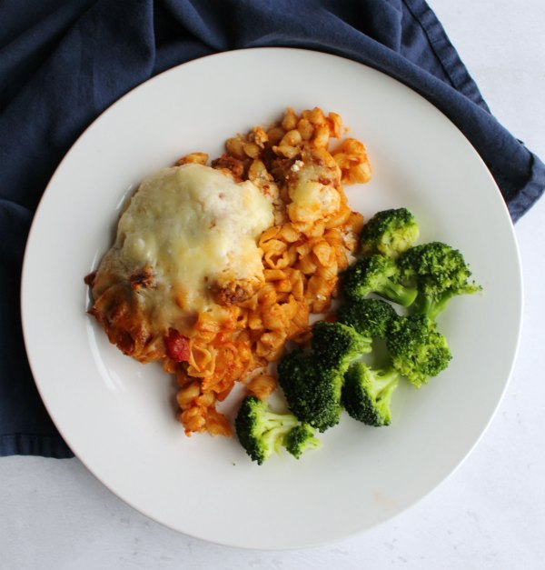 dinner plate with baked Italian style pasta casserole and broccoli