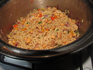 A pot of cooked noodles