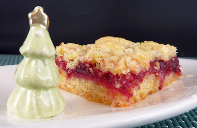 Photo of Cranberry Bars on a small plate with a tree