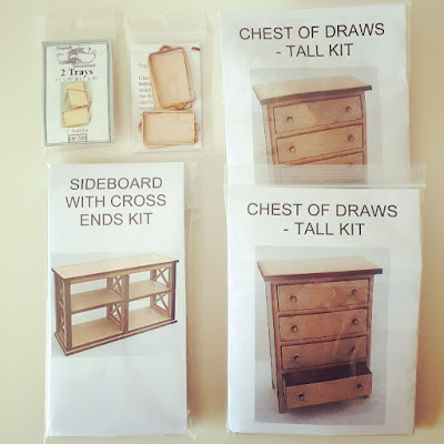 Selection of one-twelfth scale modern miniature kits including trays, chests of drawers and a bookcase with cross ends