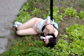 A girl tied to a poll nacked think