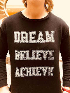 Sweatshirt with the words, Dream, Believe, Achieve