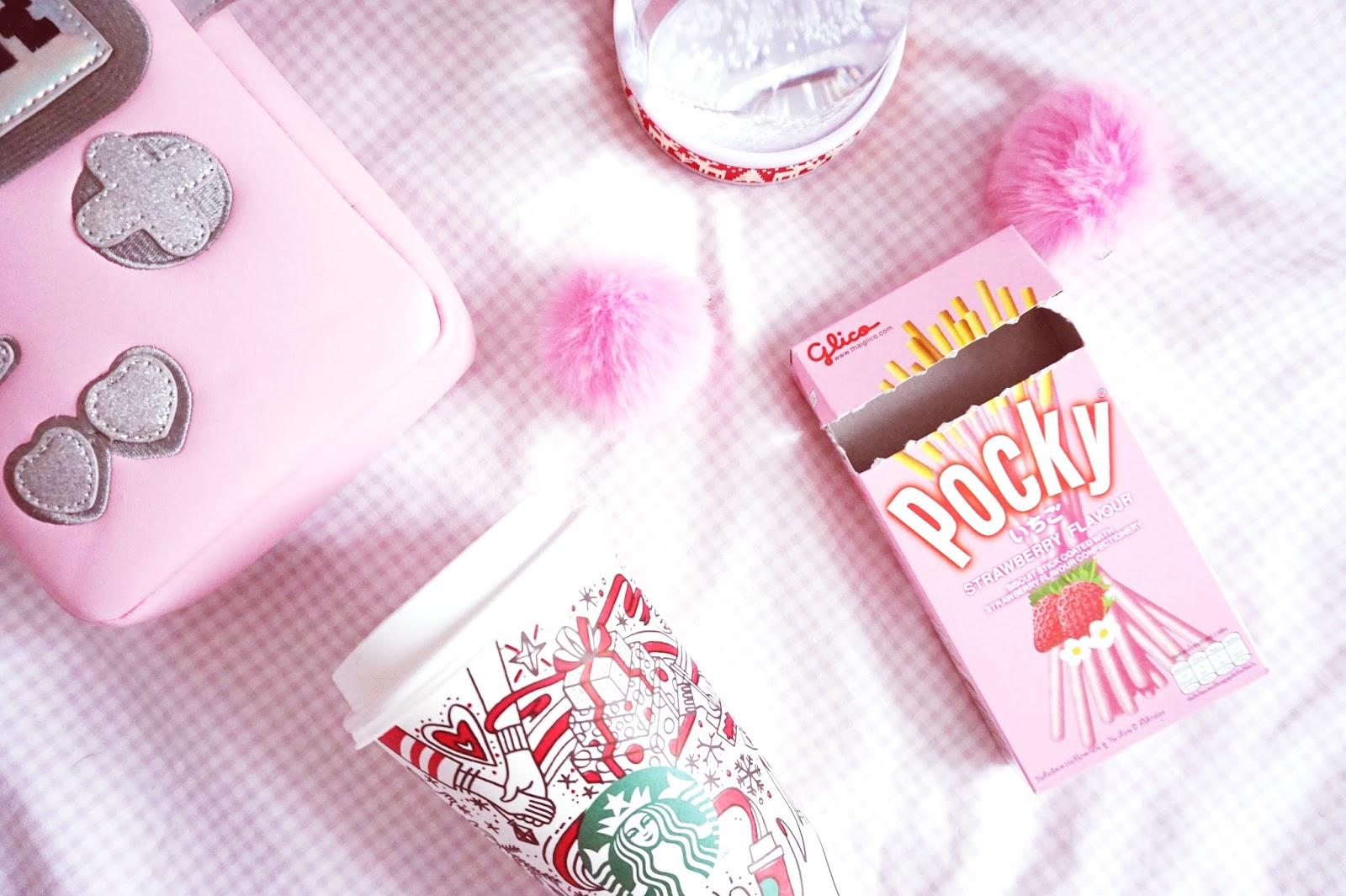 pink pretty pocky fluffy pom poms flatlay