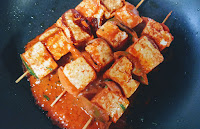 Cooking paneer on Tawa for paneer Tikka