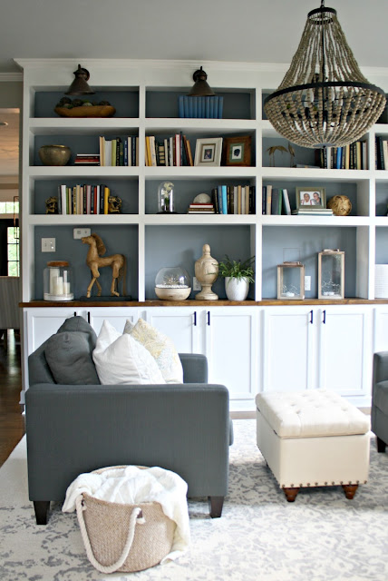 DIY bookcase wall with kitchen cabinets