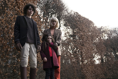 "Photo: Finn Wolfhard, Brooklynn Prince, and Mackenzie Davis star in the 2020 horror film ""The Turning."""