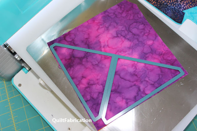 triangles cut from a pink square