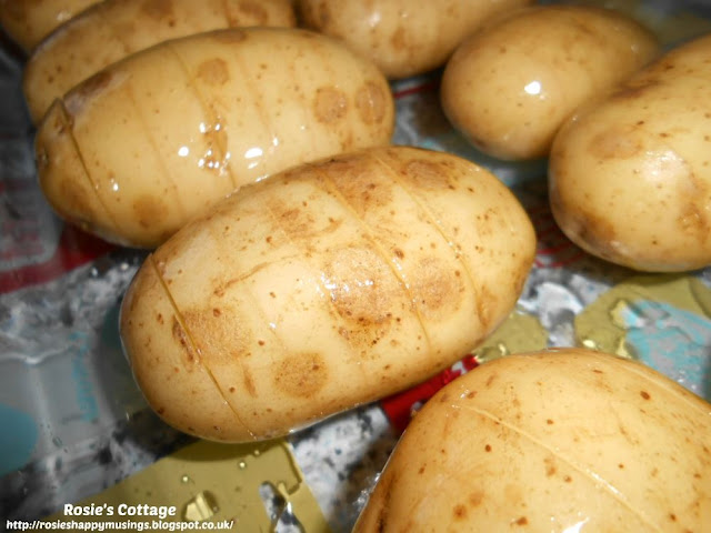 Marvellous Mini Hasselback Potatoes - Coat the sliced potatoes thoroughly in olive oil allowing the oil to seep into the slices