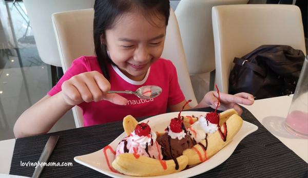 Seda Atria breastfast buffet - waiter - Bacolod blogger - Bacolod mommy blogger - bacon for breakfast - family travel - Iloilo City - Misto - banana split - dessert