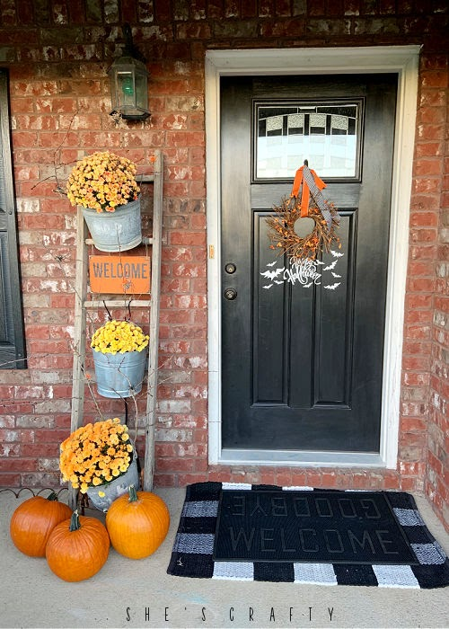 Halloween porch - vintage ladder and with mums and pumpkins