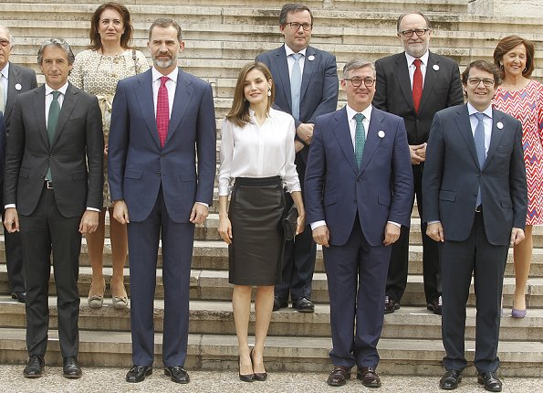 Queen Letizia wore Hugo Boss Sepai leather skirt, Boss blouse, Magrit Leather Pumps, Felipe Varele clutch and Tous pearl earrings
