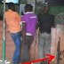 Policeman Was Spotted Gambling Sports Bet With Others While His Gun Was On The Ground {PHOTOS}