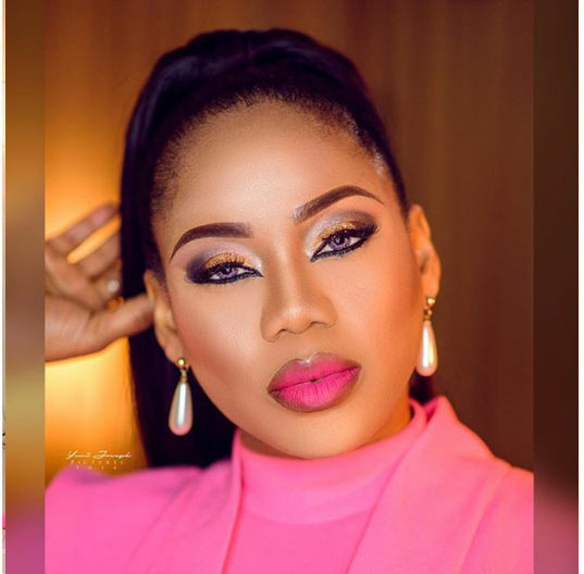 Photos: Actress Toyin Lawani sizzles in pink