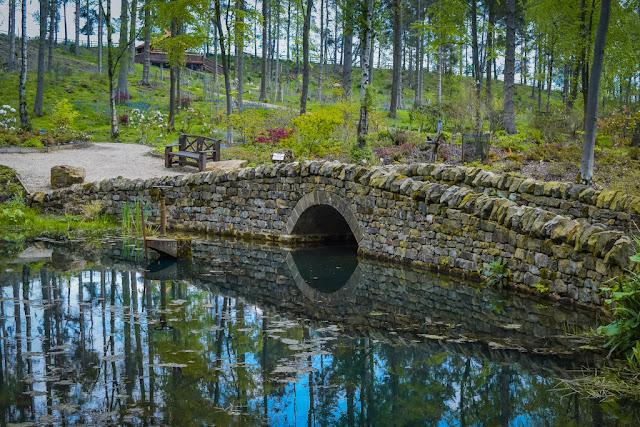 Himalayan Garden and Sculpture Park stone bridge over lake