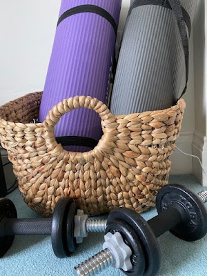 Exercise equipment in a basket at home