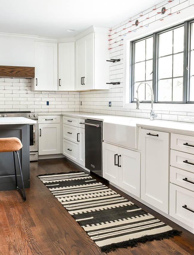 White neutral kitchen with open shelves