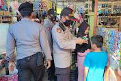 Kapolsek Cendana Bersama Personil Beri Himbauan Protokol Kesehatan di Pasar