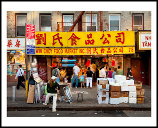 a photograph of a busy market in chinatown in new york city