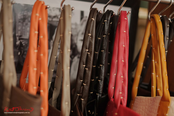 Details - hand stitching on the handles of Catherine Loiret handbags in a range of colours. Photography by Kent Johnson.