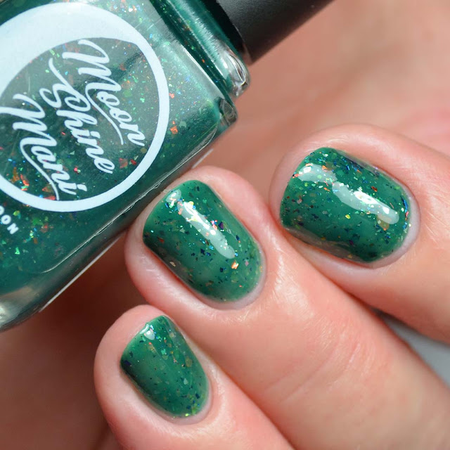 green nail polish with flakies swatch