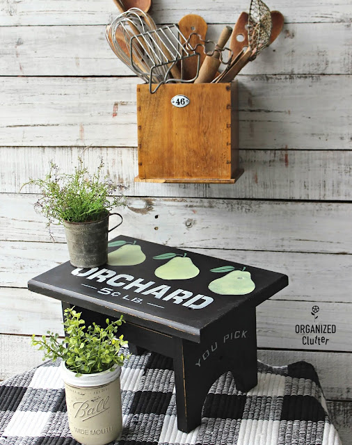Photo of an upcycled thrift shop stool with paint and stencils.