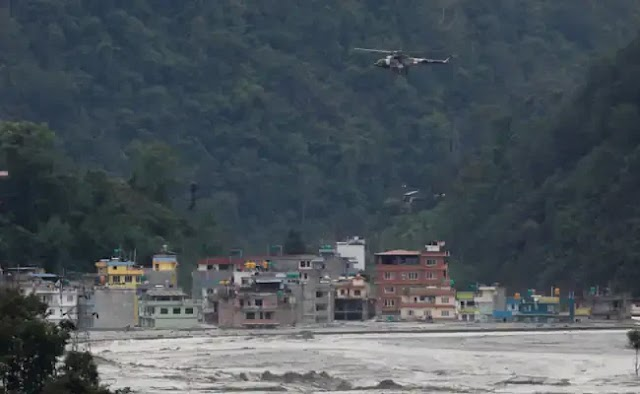 Ten people are killed and seven others are missing in flash floods in Bhutan and Nepal.