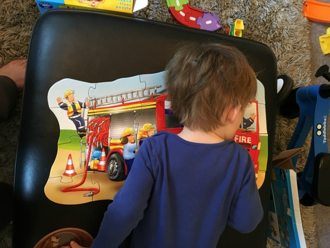 Our-Weekly_Journal-27-Feb-2017-toddler-with-head-on-puzzle