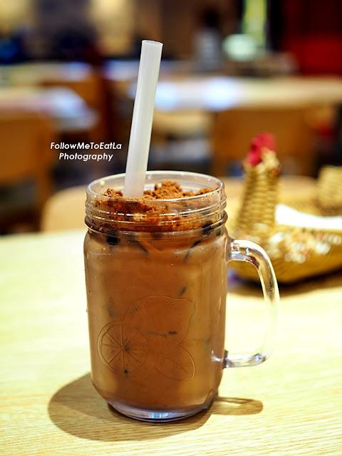 a glass of DINO Choco Malt