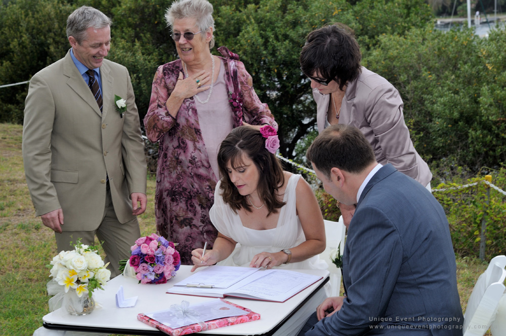 Signing the wedding registry, Garden Wedding Photographer Sydney.