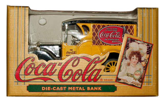 A collectible truck bank from Erl with Coca-Cola's red logo on the side.