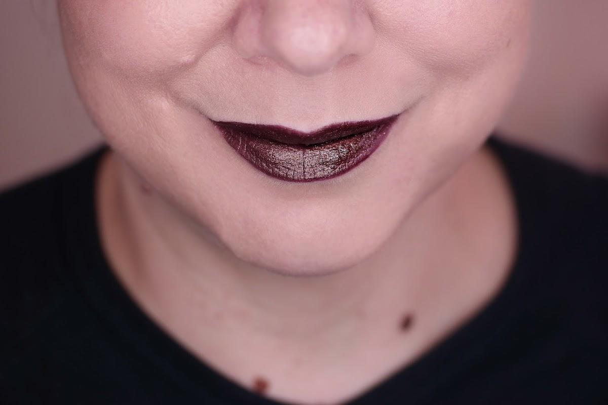 Conspiracy schimmernder Pflaumenton für die Lippen