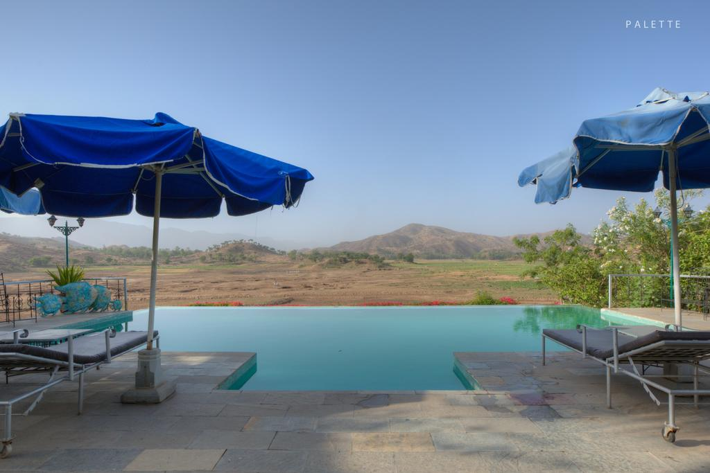 JHADOL SAFARI RESORT Situated in Udaipur, 46 km from Bagore ki Haveli, Jhadol Safari Resort features accommodation with a restaurant, free private parking, a garden and a terrace. With free WiFi, this 3-star hotel offers a 24-hour front desk and room service. The hotel has family rooms.  All rooms in the hotel are fitted with a flat-screen TV with cable channels. At Jhadol Safari Resort rooms are equipped with air conditioning and a private bathroom.  A continental breakfast is available each morning at the accommodation.  Jagdish temple is 46 km from Jhadol Safari Resort, while City Palace of Udaipur is 47 km from the property. The nearest airport is Maharana Pratap Airport, 71 km from the hotel. FOR BOOKING CALL US ON 8000999660, 9427703236. AKSHAR TRAVEL SERVICES, GROUND FLOOR-11 VISHWAS CITY PART-1 R C TECHNICAL ROAD, GHATLODIA, AHMEDABAD. DOMESTIC AND INTERNATIONAL AIR TICKET BOOKING, RAILWAY TICKET BOOKING, BUS TICKET BOOKING, GSRTC BUS TICKET BOOKING, HOTEL BOOKING, TOUR PACKAGE, PASSPORT ASSISTANCE, TRAVEL INSURANCE, WIRE TRANSFER SERVICES, FOREX CARD, TRAVELLER CHEQUE/DEMAND DRAFTS, LIFE INSURANCE SERVICES, WESTERN UNION MONEY TRANSFER, CAR RENTAL. E-mail : info.akshar@gmail.com