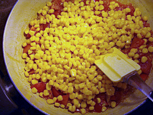 Cod and corn chowder with saffron by Laka kuharica: add the tomatoes, and sweetcorn kernels