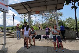 People at but stop in Ciudad Colon, Costa Rica