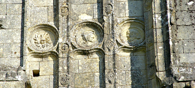 Decorative medallions on the western front of the ruined church of Les Roches Tranchelion.  Photo by Loire Valley Time Travel.