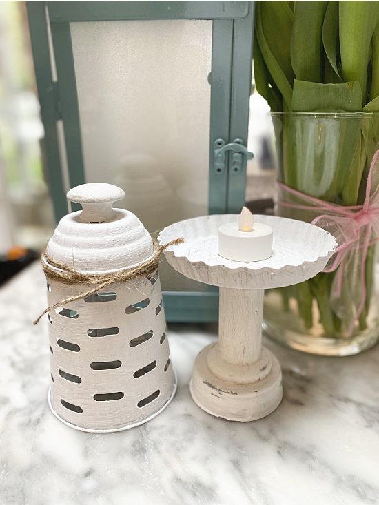 white painted lantern parts with candle
