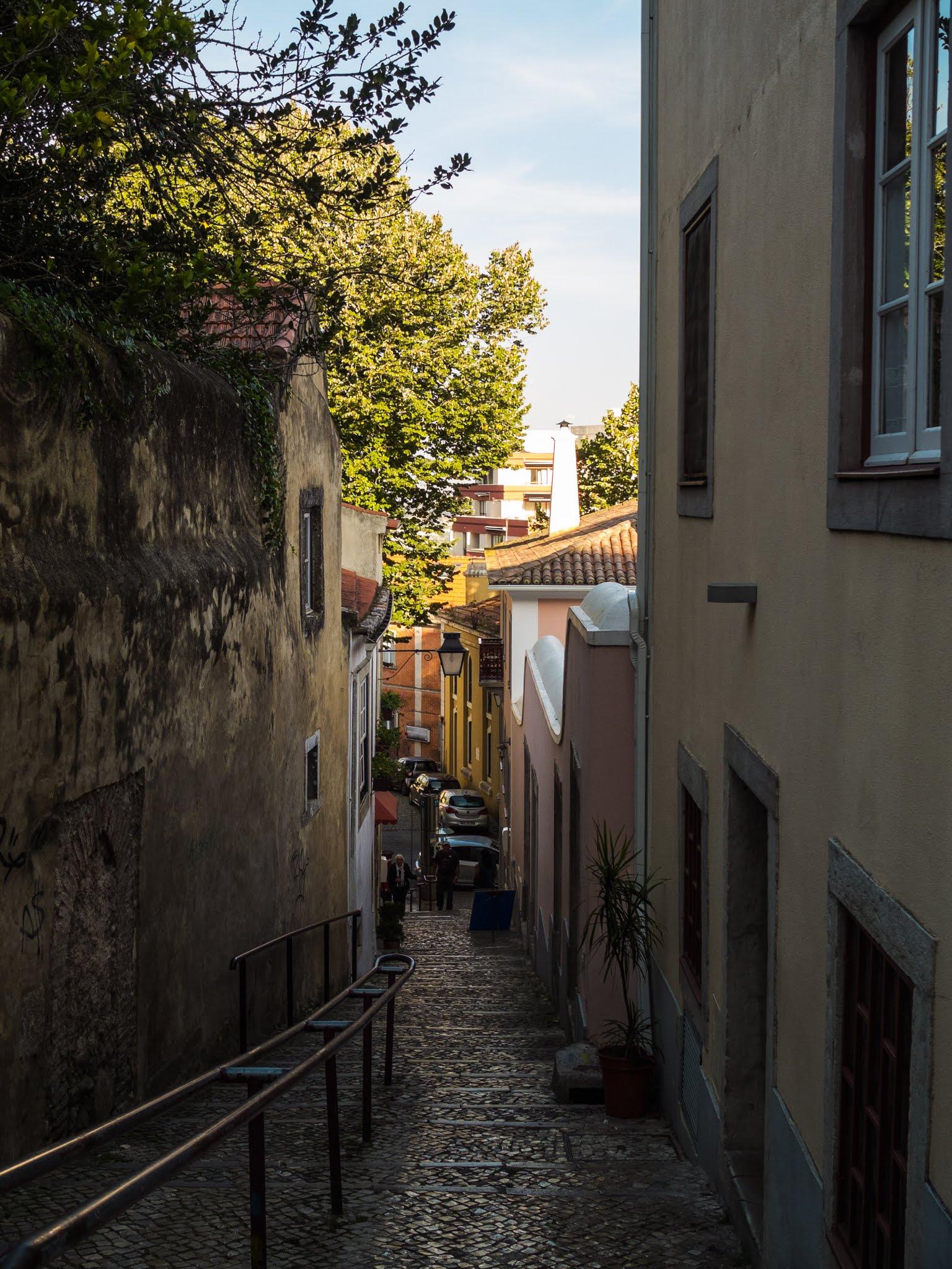 Walking downhill a narrow street in Sintra, Portugal.