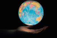 Earth in hand - Photo by Greg Rosenke on Unsplash