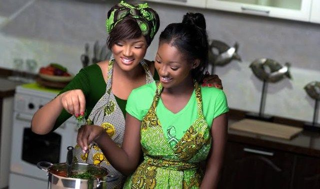 Mother teaching daughter how to cook