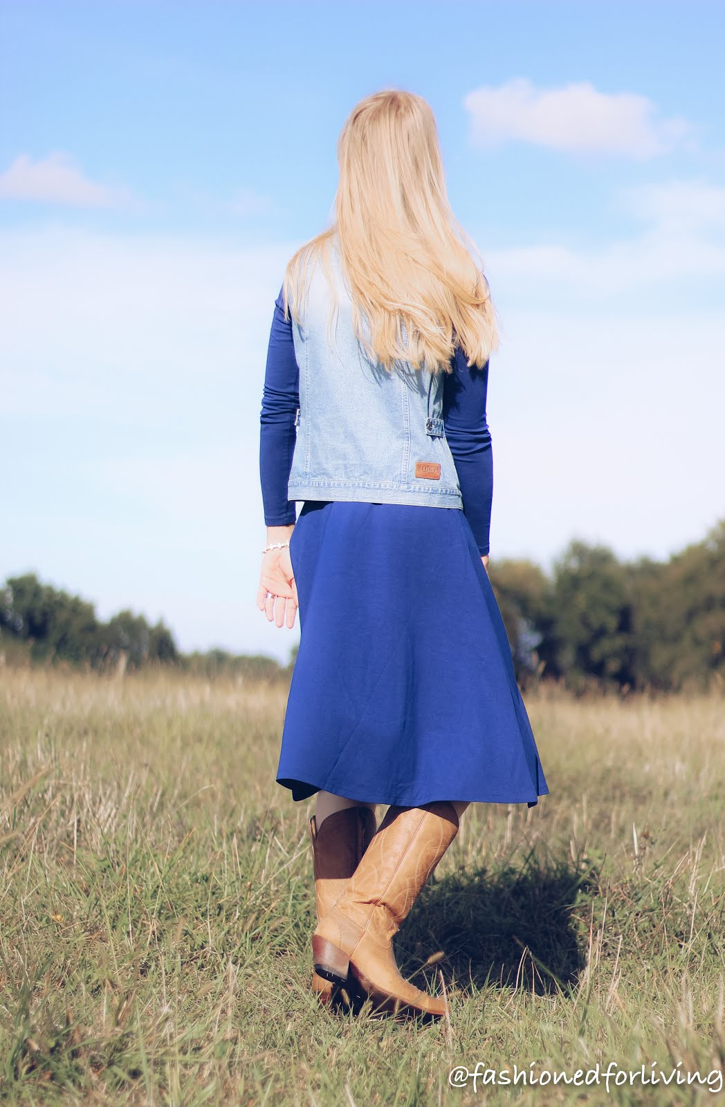 womens dress outfit with cowboy boots and denim vest