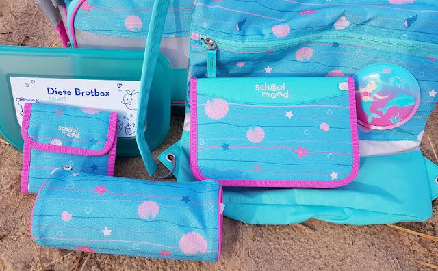 Einschulung 2021: Ein Meerjungfrauen-Schulranzen für unser Küstenmädchen. Maritmes Design mit Muscheln und Seesternen in hellblau und pink.