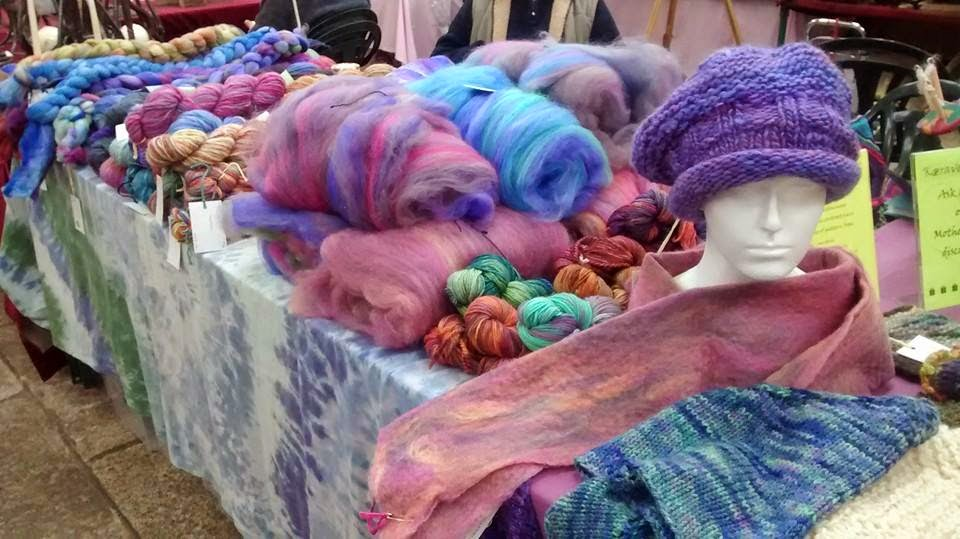Photo of woollen goods on market stall