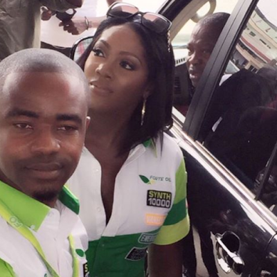 Tiwa savage serving customers at petrol station as attendant